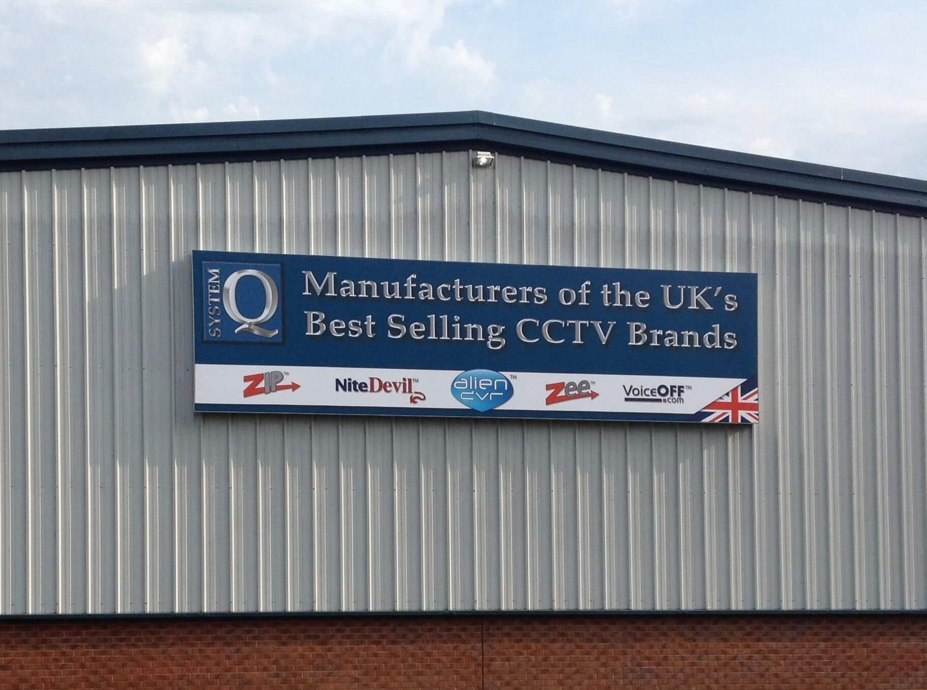 System Q Warehouse sign